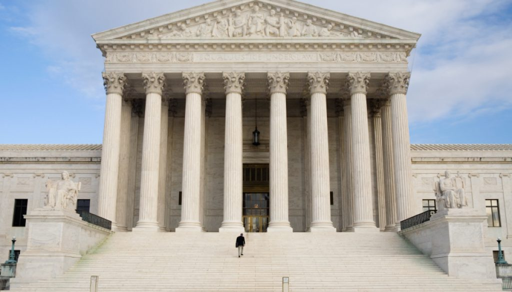 US Supreme Court with Man Walking up Steps